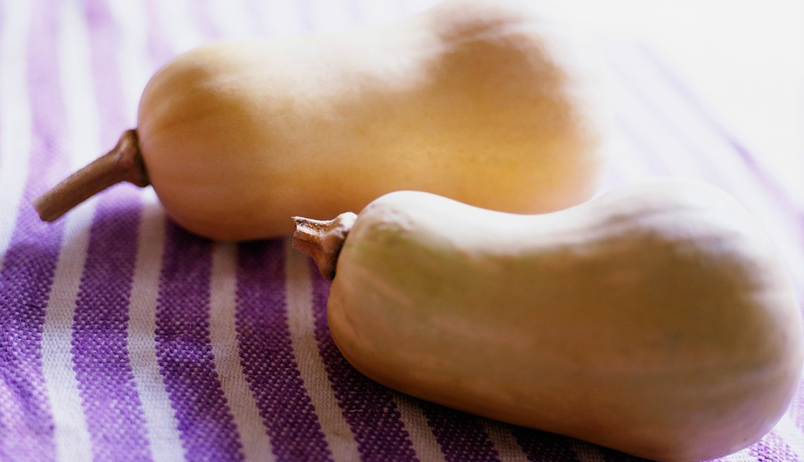 Butternut squash on a purple cloth, Fat Busting Fall Foods