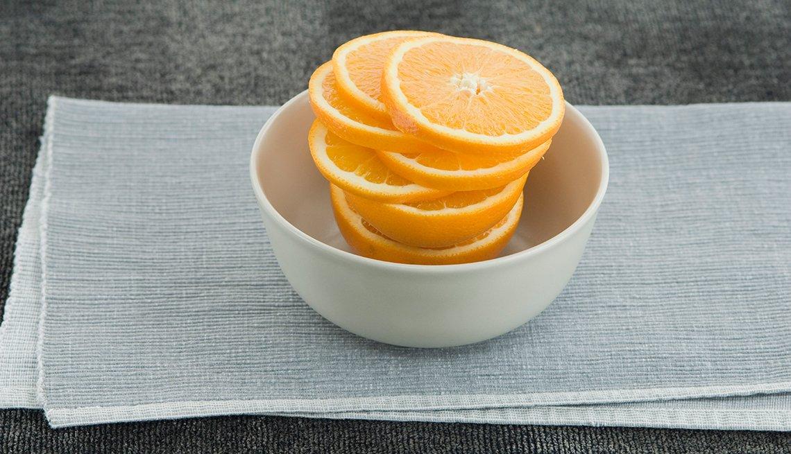 Naranja rebanada en un envase