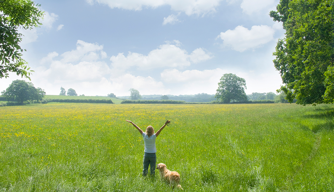 Woman in a field with a dog, Embracing nature, Mini workouts work