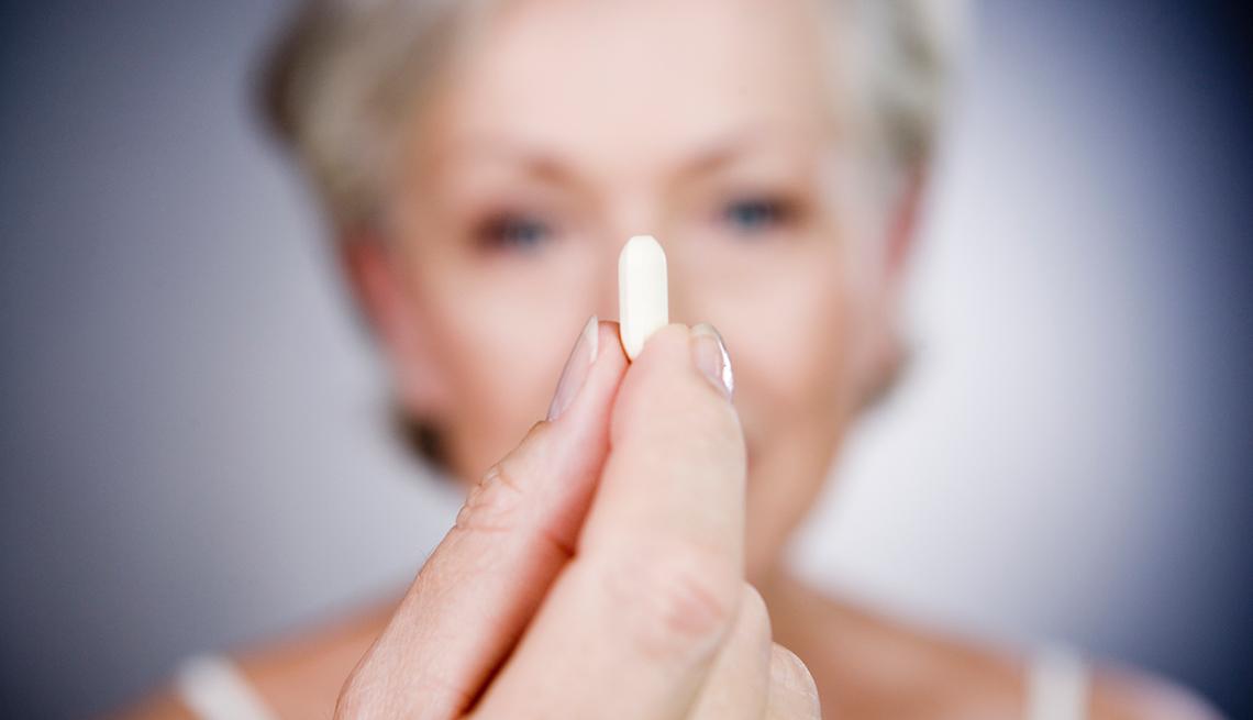 Woman displays a pill, Good Habits Go Bad