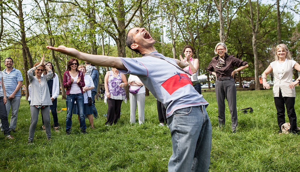 Man demonstrates yoga laughter,