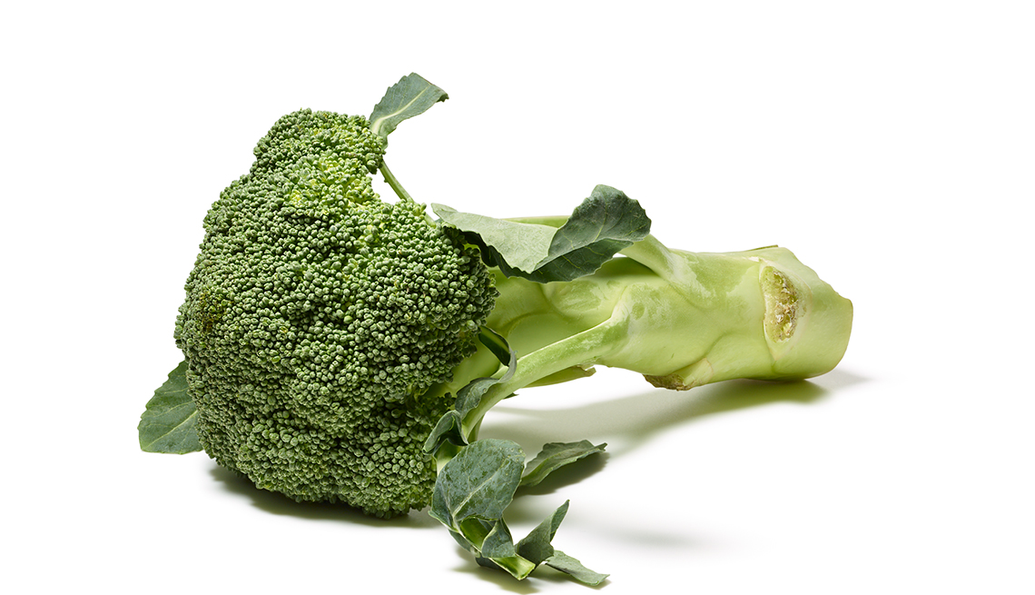 Fresh broccoli on a white background. Foods That Fight Cancer