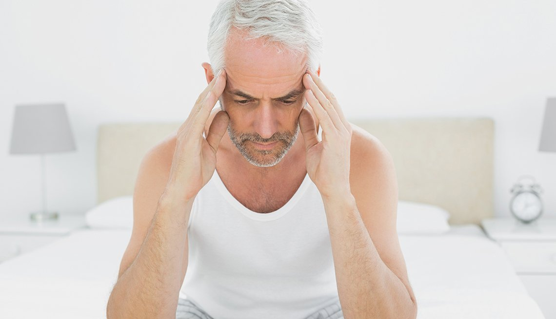 Man with headache, bedroom, 7 Reasons to Have More Sex After 50