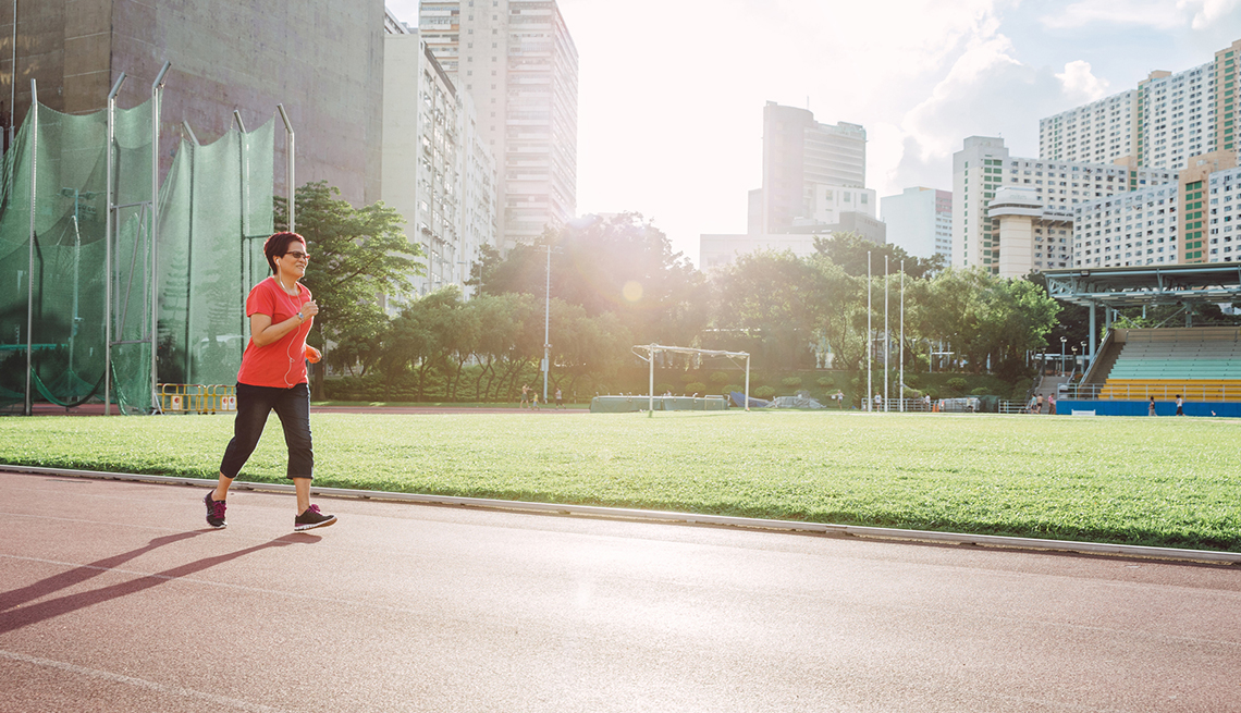 Mature Woman Listening to Music while Running, Coach Potato Syndrome, Healthy Living