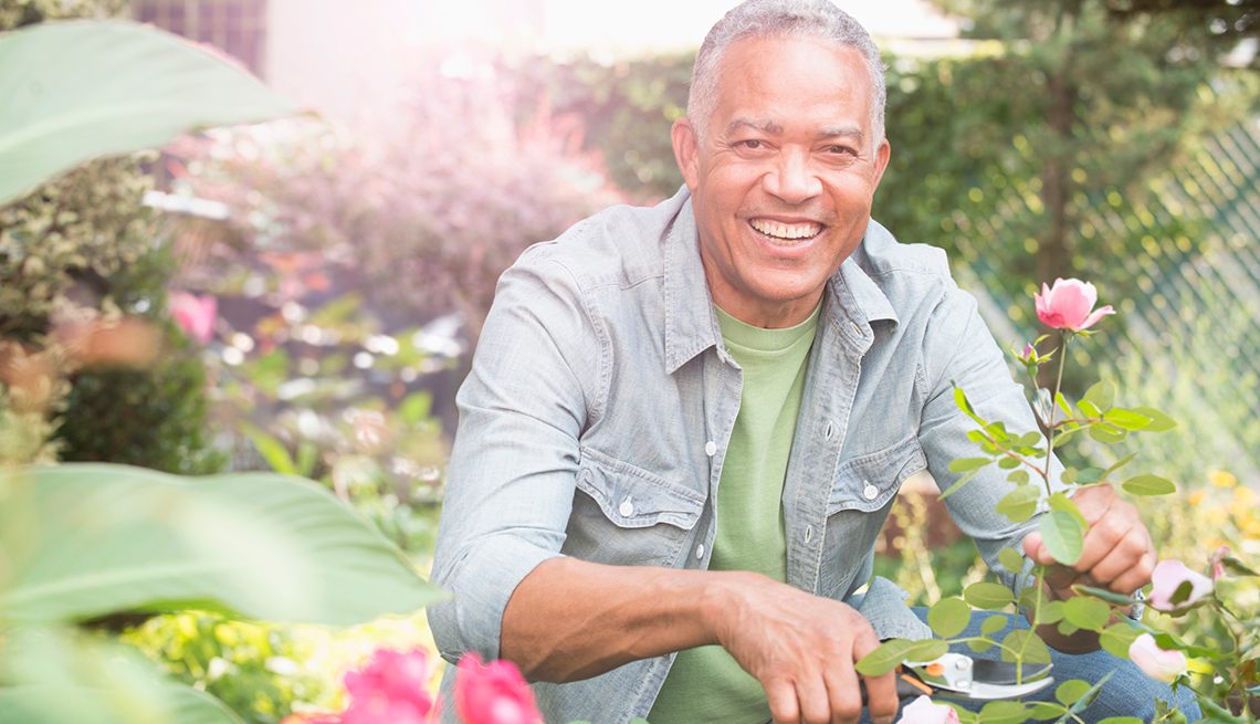 Man Smiling working in a Garden, More than one Great Life,