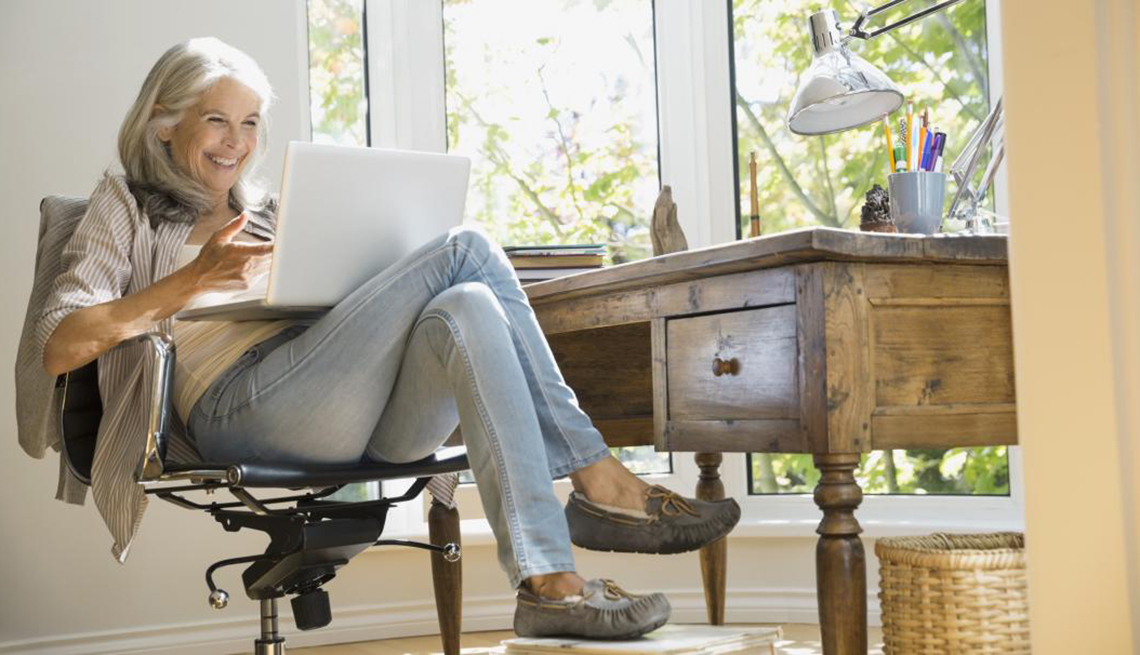 Woman at desk using a Laptop, More than one Great Life