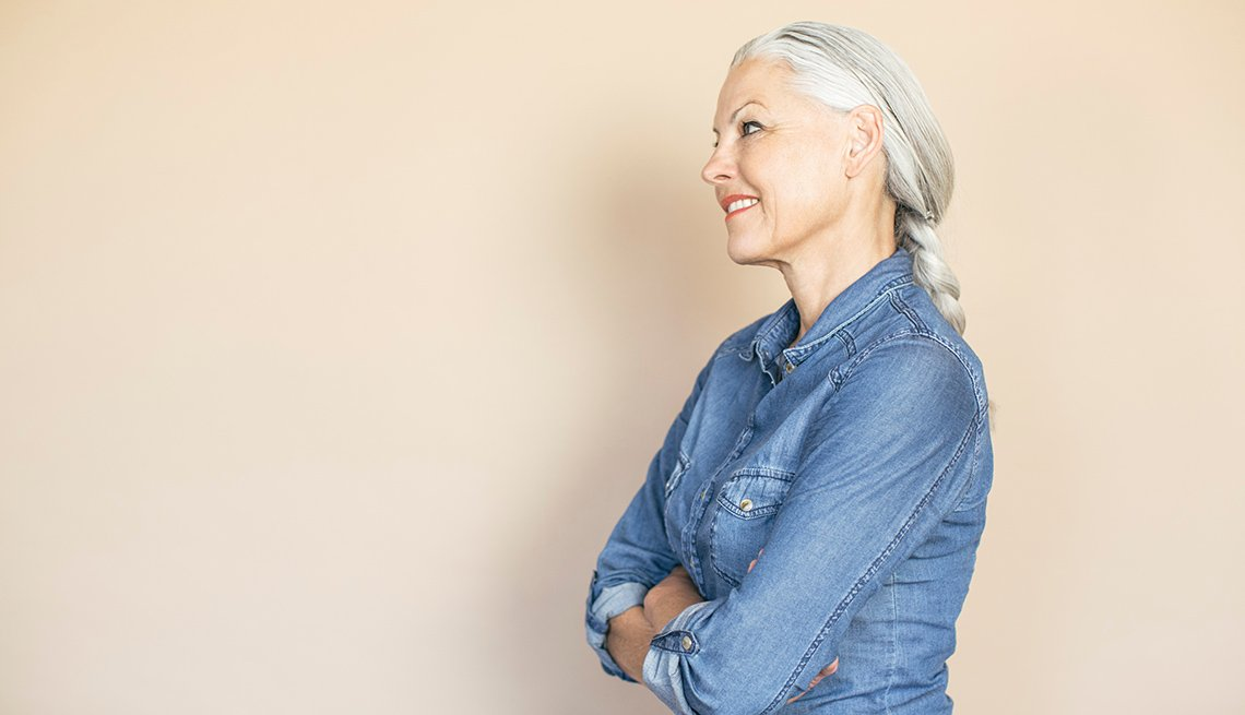 Side Portrait Of A Smiling Middle Aged Caucasian Woman Against Pink Background, Great Things About Getting Older