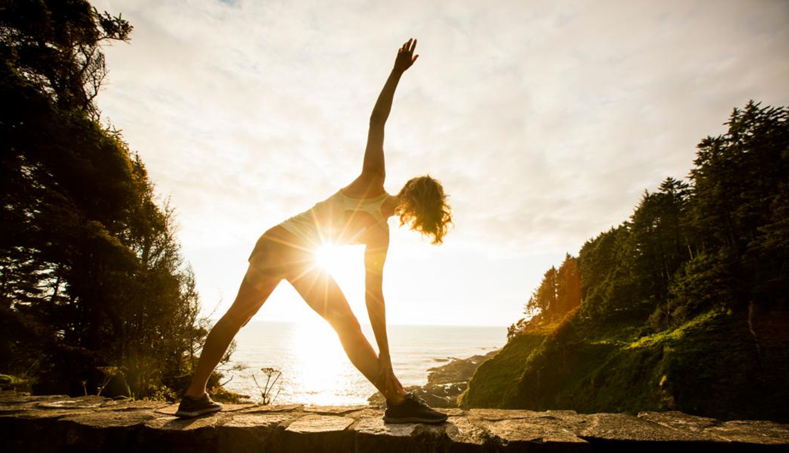 Woman stretching in the Sunlight, Stretch your Lifespan, Healthy Living
