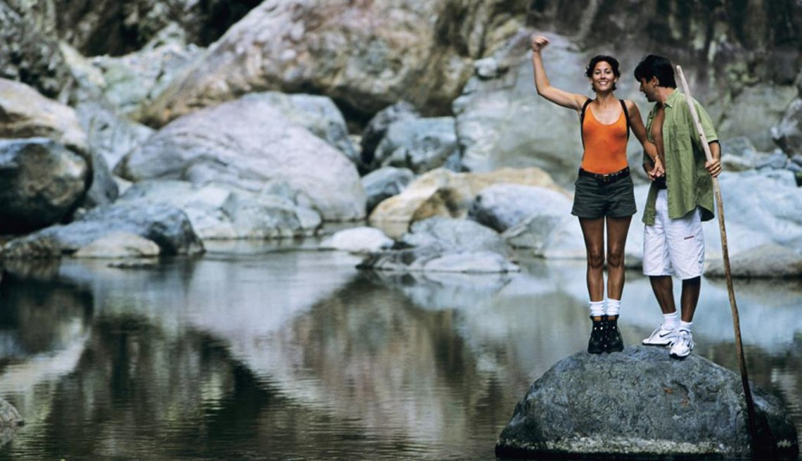A Man and Woman Standing on Rock in Water, Walk Your Way to a Better Life, Healthy Living