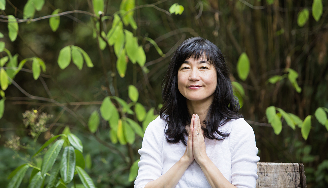 Asian Woman with Hands Clasped, Outside in a Garden, Home and Family, Health, Why It's Important to Celebrate.