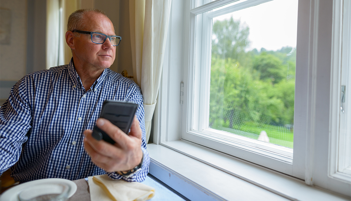 Man looking out window, Early Retirement