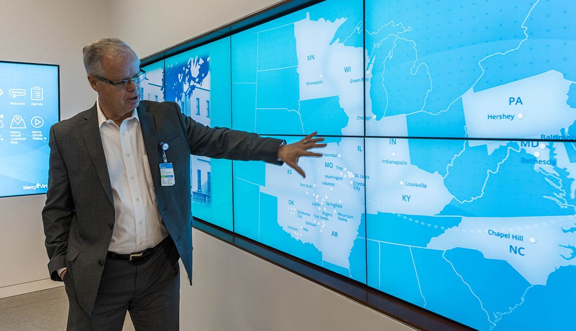 Randall moore pointing at a map