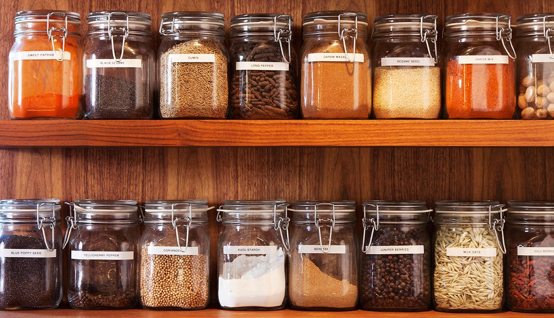 Wooden shelves of spices in glass jars