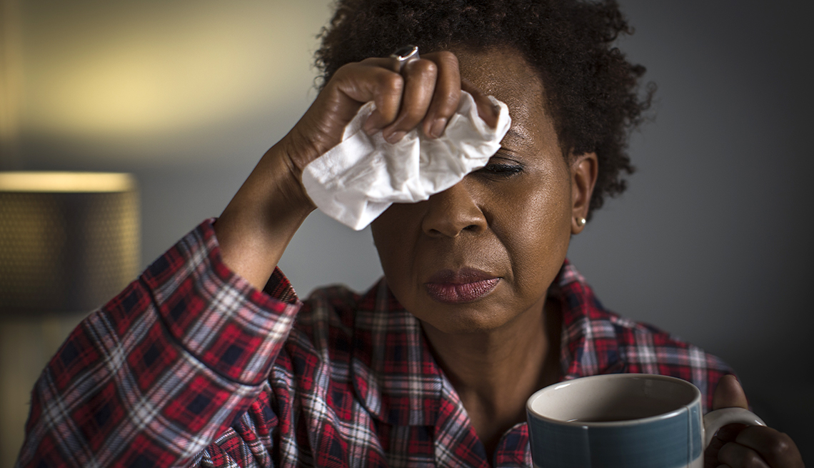 woman with fever resting at home with tea