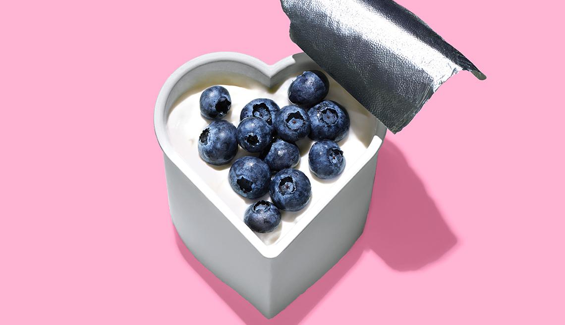 Heart shaped yogurt with blueberries