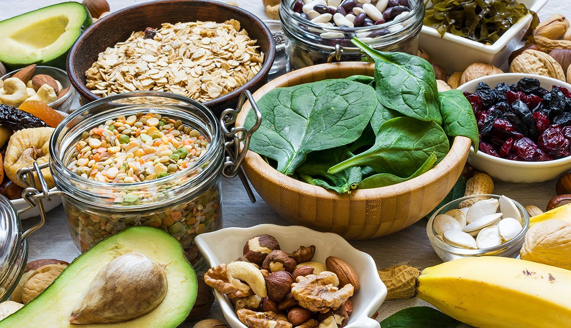 Magnesium rich foods including leafy greens, beans, nuts, and avocado