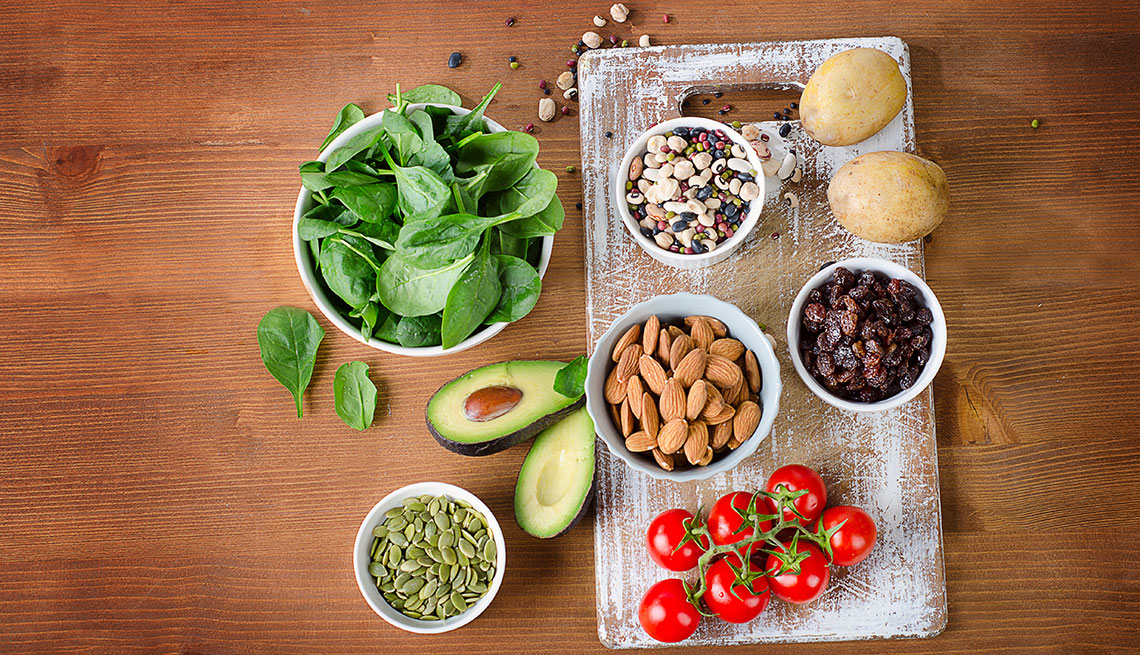 Foods containing potassium on wooden table