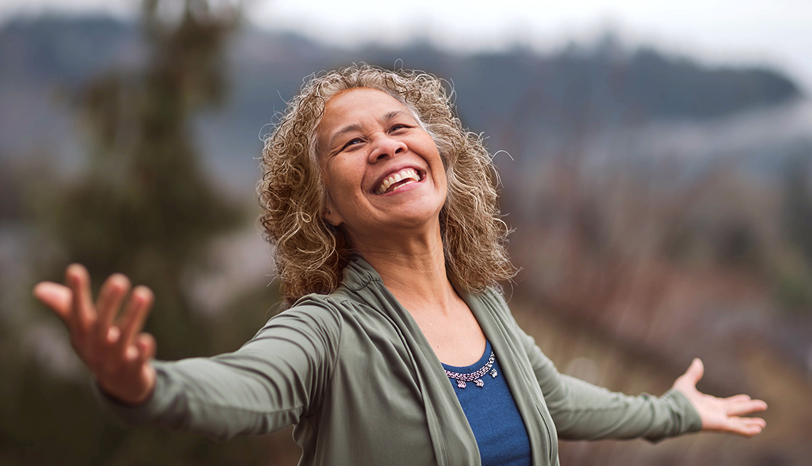 mature woman joyous to be outside