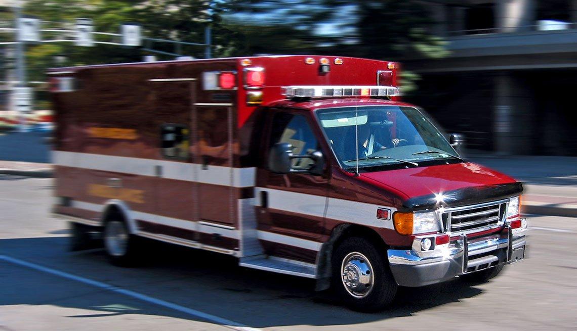 Red Ambulance rushing through traffic