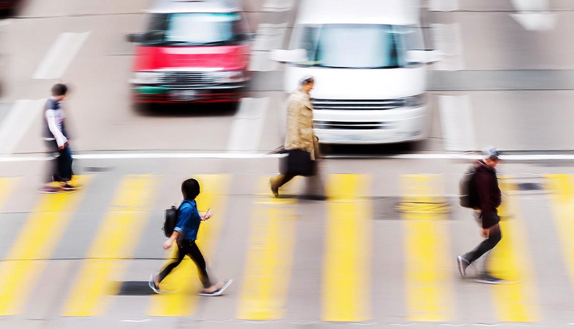Pedestrians cross a city street