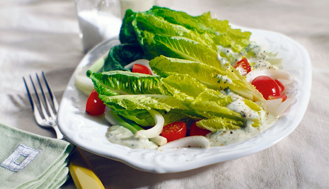A Salad of Romaine Lettuce, Cherry Tomatoes, Onions and Green Goddess Dressing