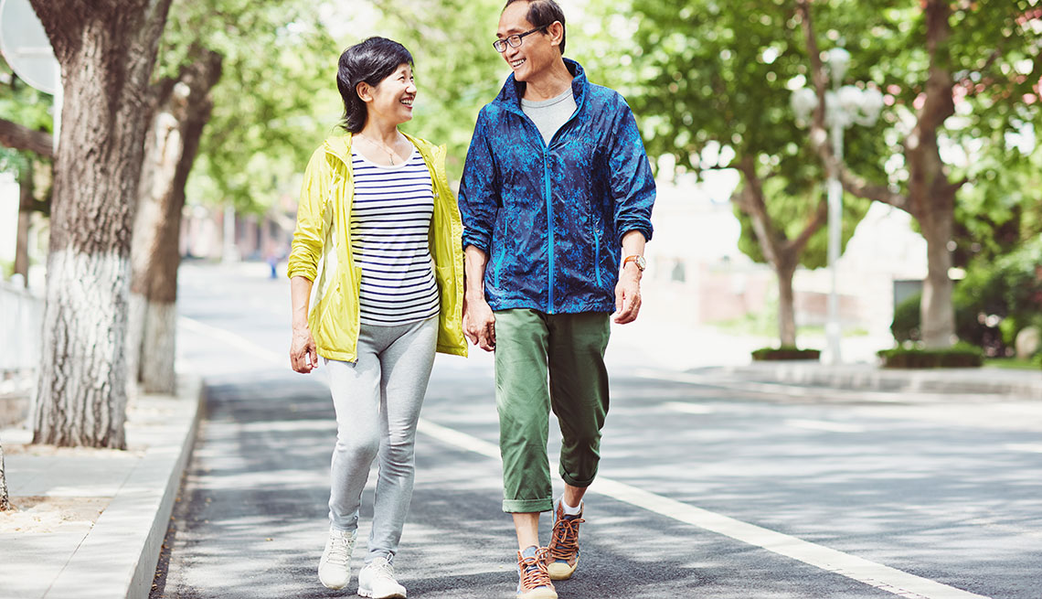 Mature couple talking while walking