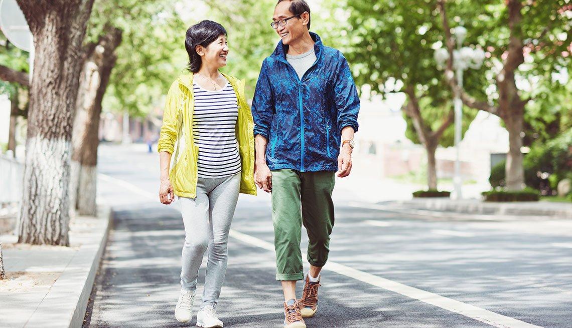 Mature couple talking while walking