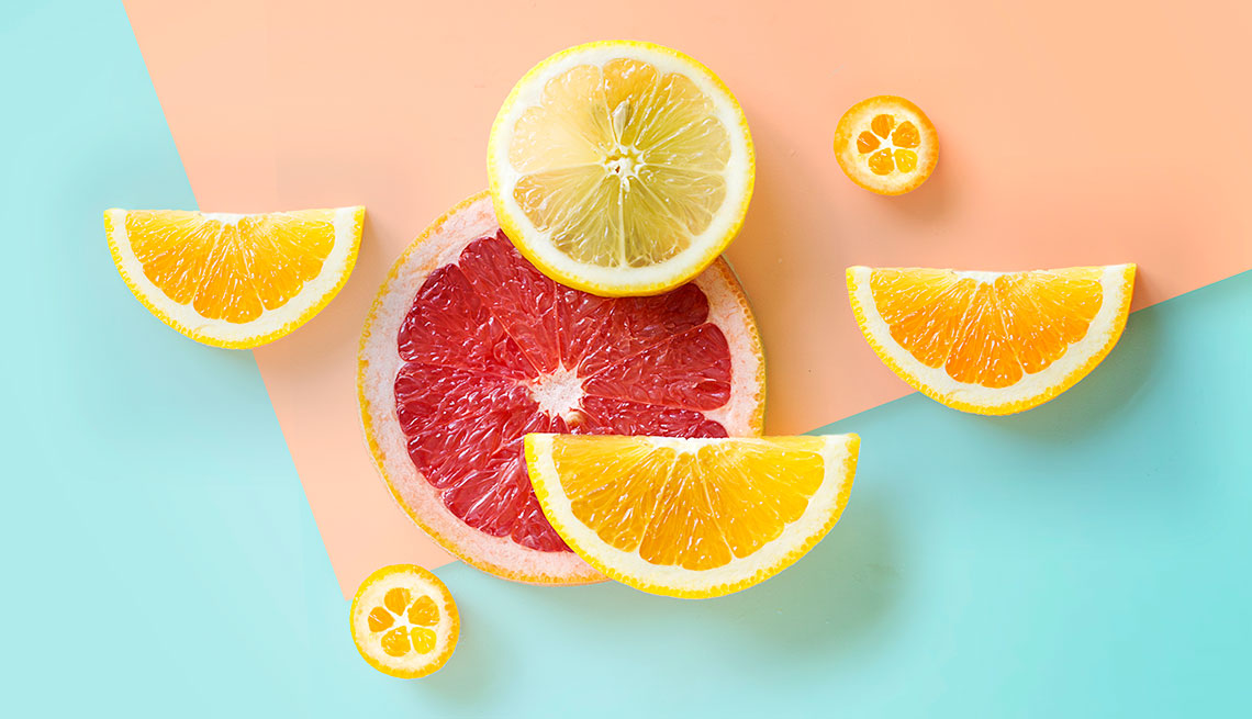 Citrus fruits lay flat on graphical background. Citrus is a good source of Vitamin C.