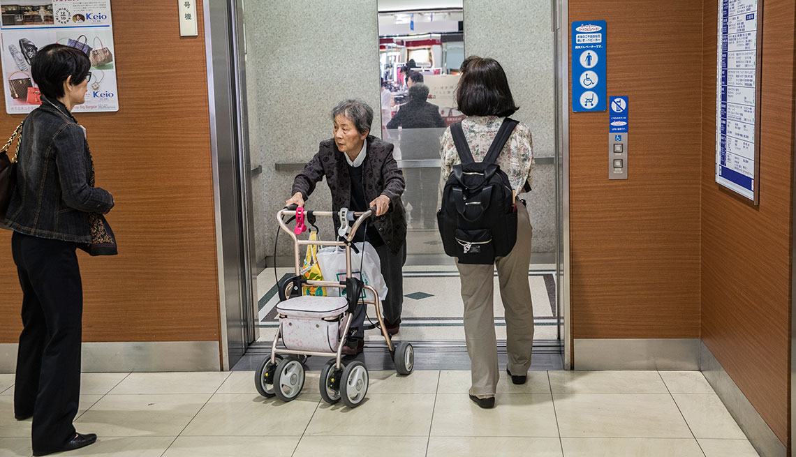 Elevators reserved for seniors, wheelchair users, and silver cars at department store in Tokyo, Japan.