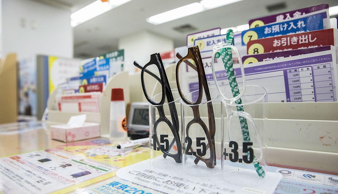 Reading glasses bearing labels  â Please feel free to use this at post office in Tokyo, Japan