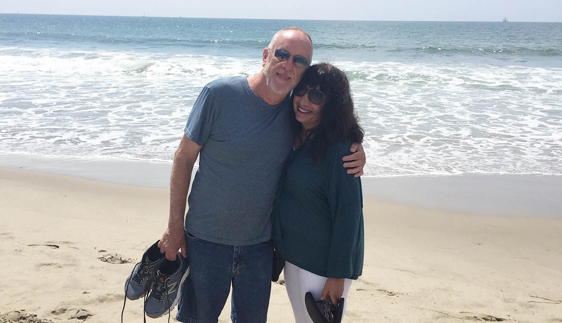 Ann Brenoff with her partner on the beach