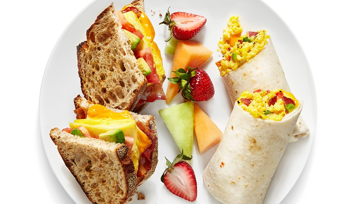 Egg burritos and an egg sandwich on the plate