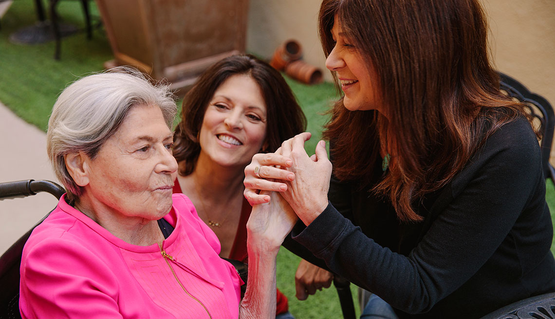 Comedian Sue Ball (right) works with Muriel Klein (left), an Alzheimer's patient, through a program called Laughter on Call at Silverado Beverly Place in Los Angeles, California February 17, 2018. Muriel's daughter Dani Klein Modisett (center) joins in