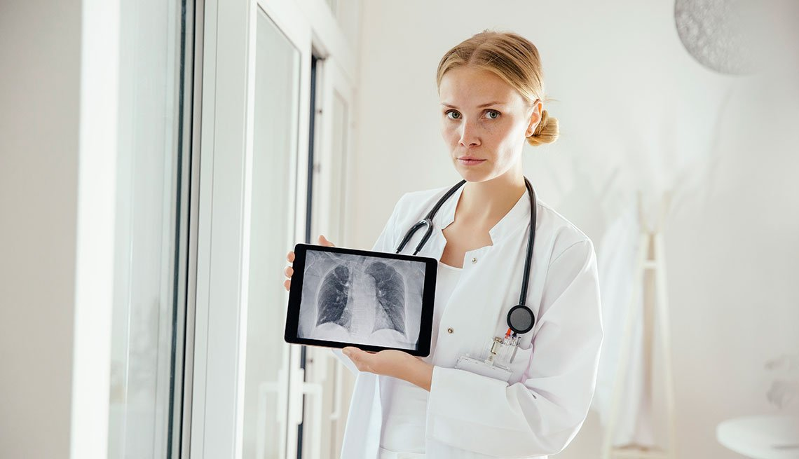 doctor holding lung scan