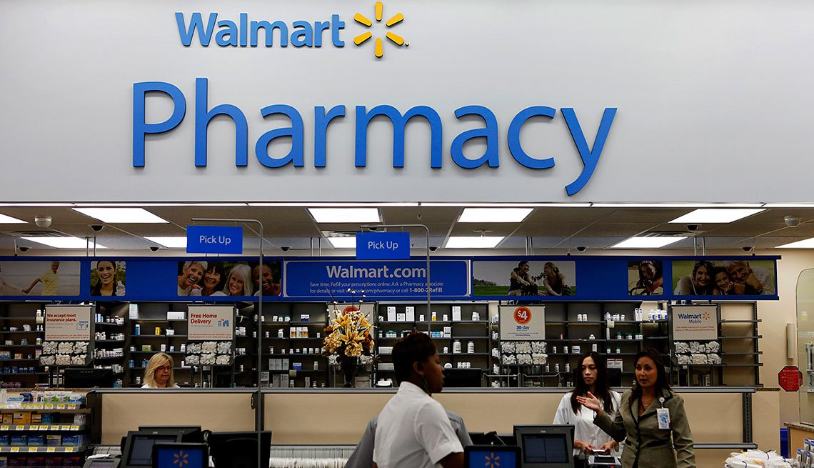 A customer walks past the pharmacy during the grand opening of a new Wal-Mart Stores Inc