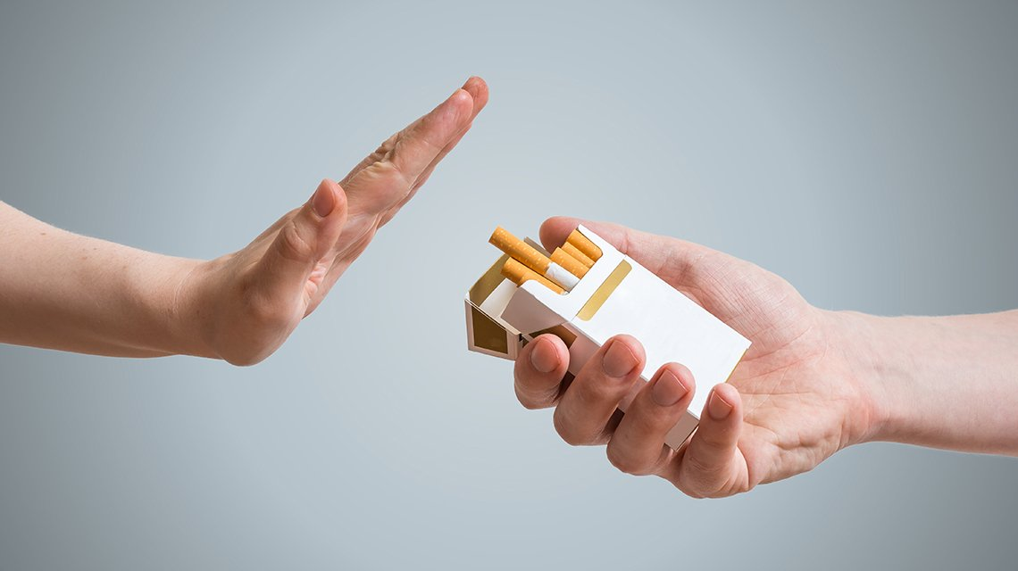Hand is refusing cigarette offer.