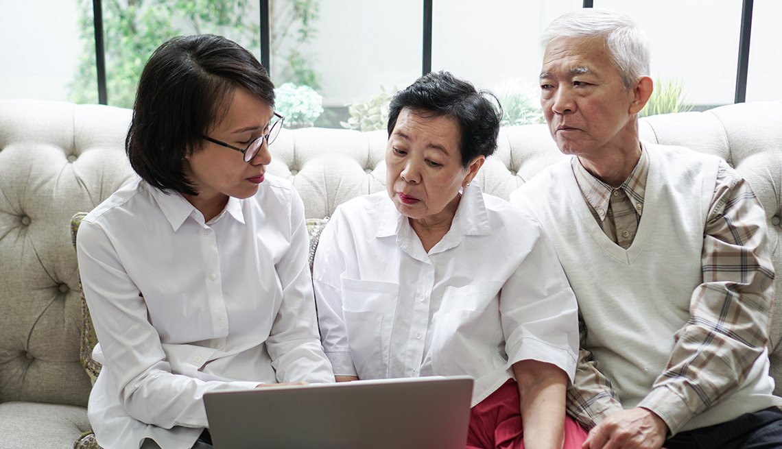 Senior couple discuss website with doctor