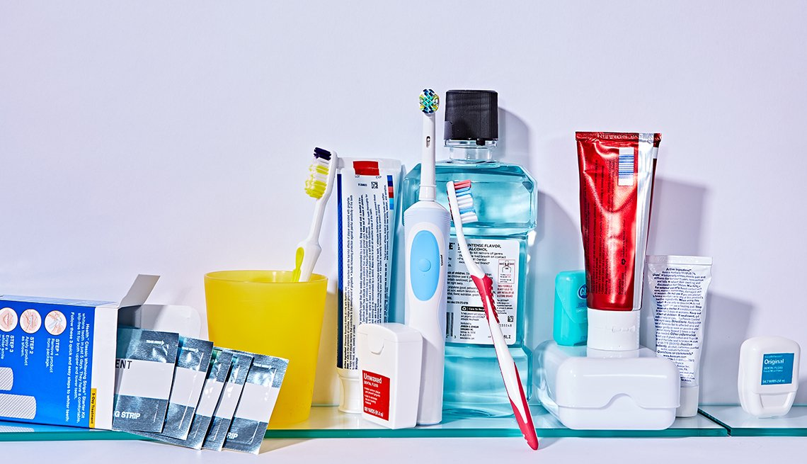 Assorted dental products including whitening strips, mouthwash, toothpaste, toothbrushes and dental floss.