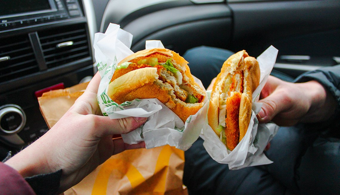 Hands holding fast food sandwhich