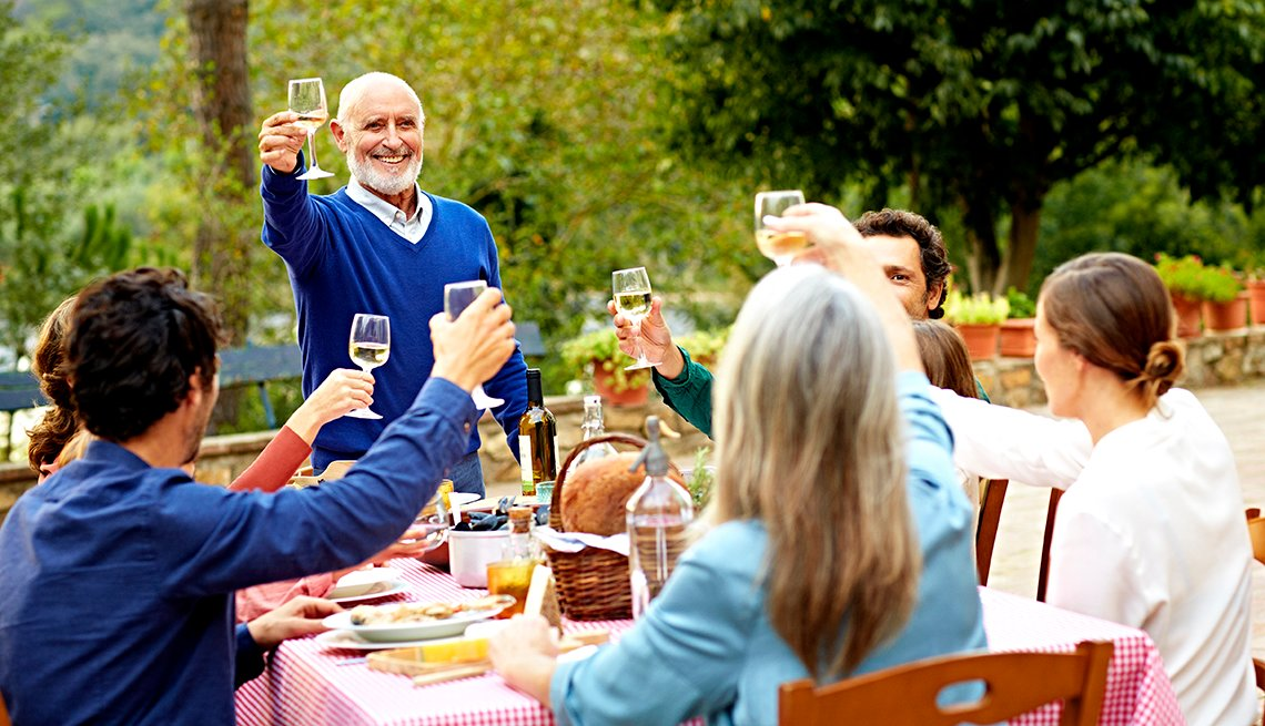 Man in Spain raising a toast with his family