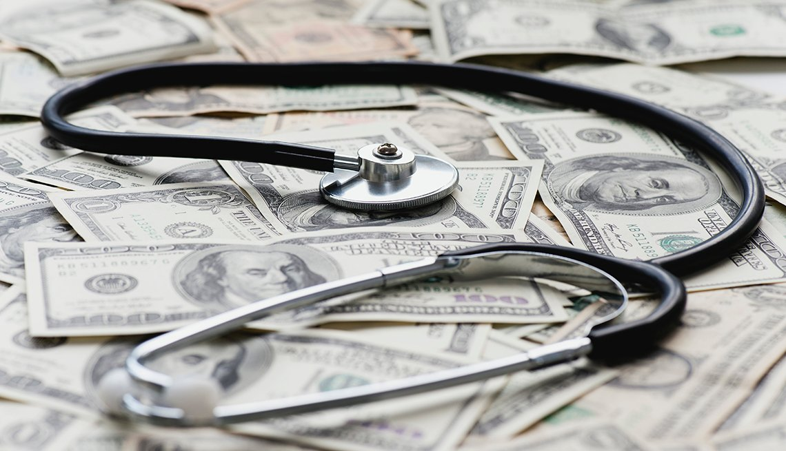A stethoscope on top of money.