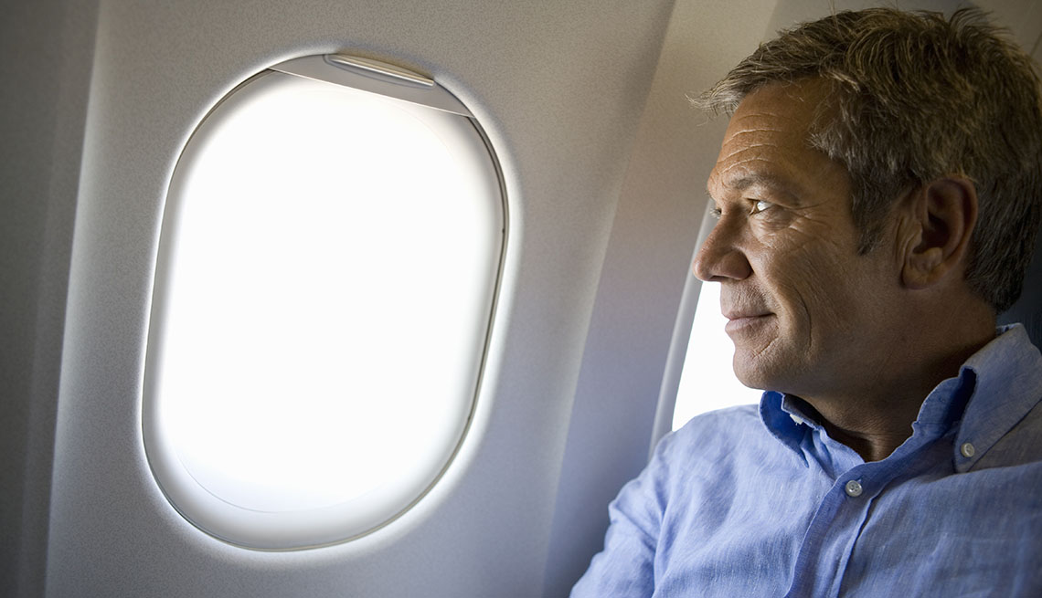 Man staring out of an airplane