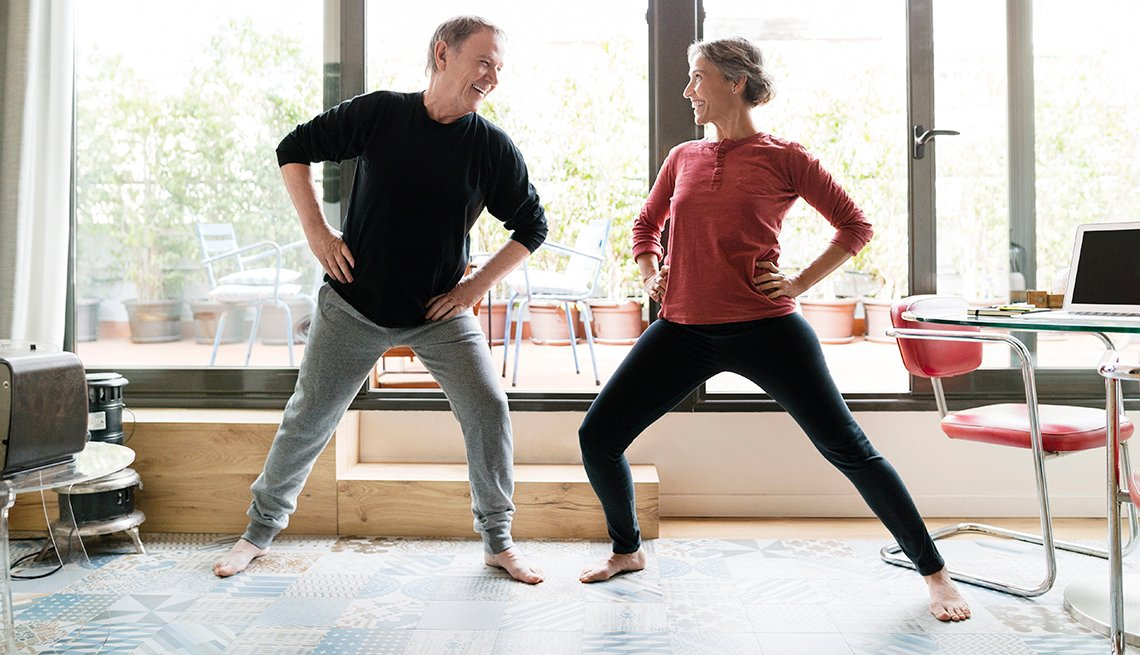 Man and woman taking an exercise break in a home office