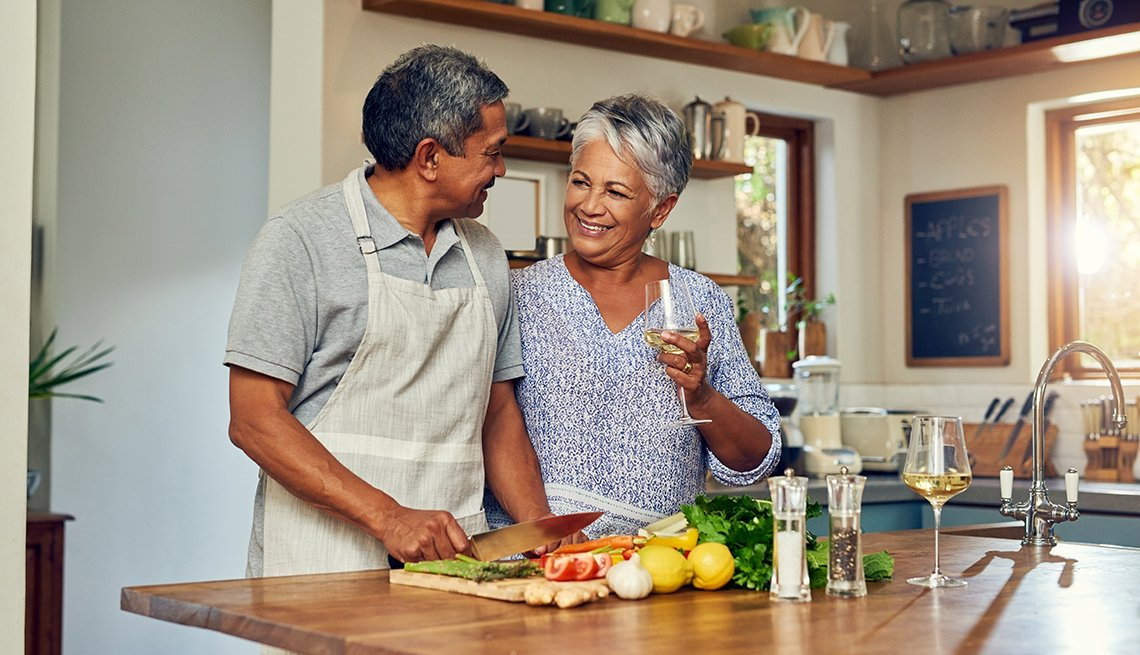 Shot of a happy mature couple drinking wine while cooking a meal together at home