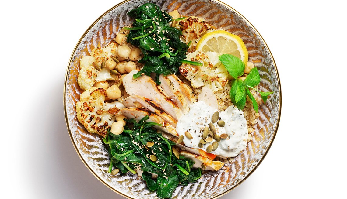 item 2 of Gallery image - A Middle Eastern food bowl featuring eggplant, spinach and chic peas.