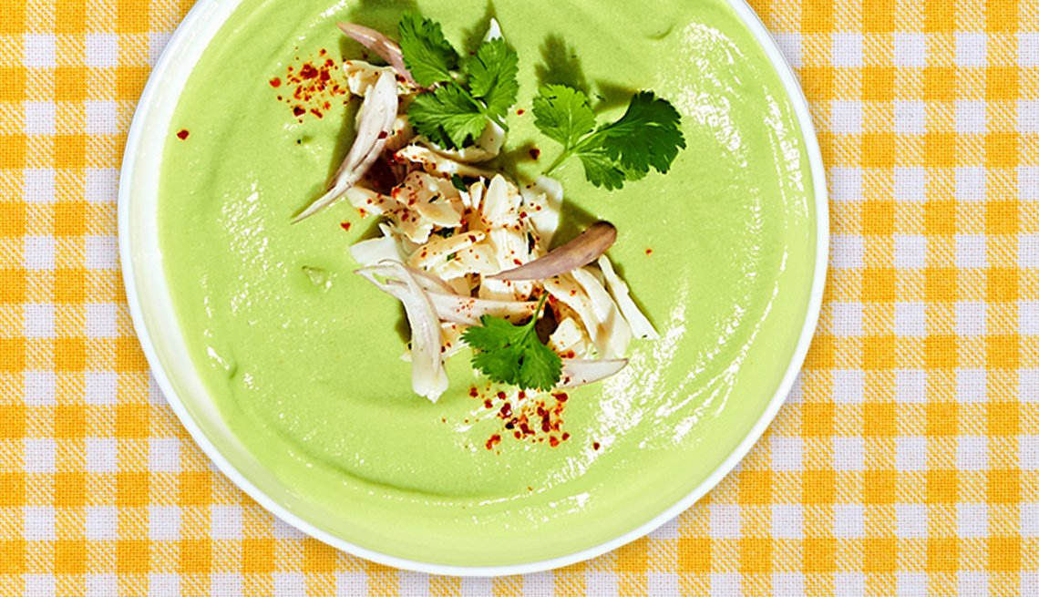 bowl of no-cook avocado soup on a table