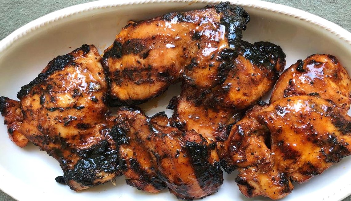a plate of smoky barbeque chicken thighs