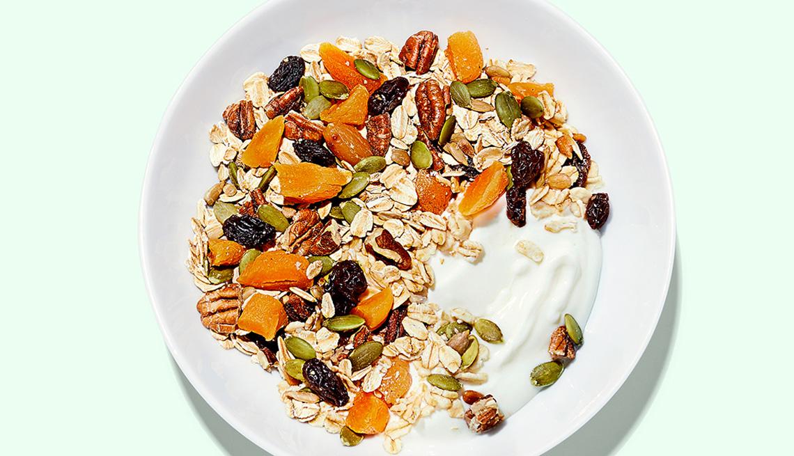 A bowl of apricot-pecan muesli