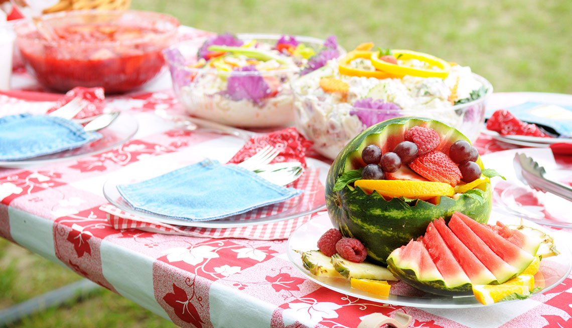 Picnic table of fruit and salads