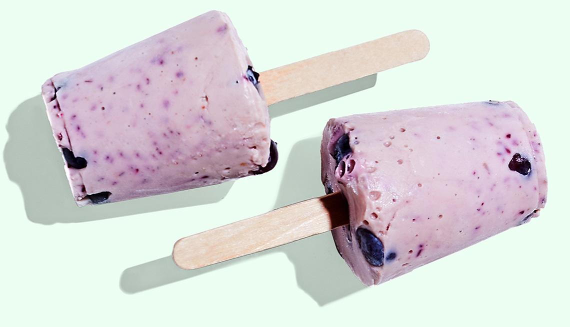 A pair of blueberry-banana yogurt pops